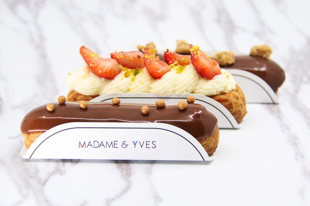 image of three eclairs, salted caramel, berries and cream and coffee eclairs
